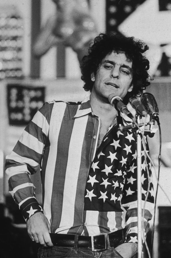 Abbie Hoffman Sopeaking At The Flag Show In Flag Shirt